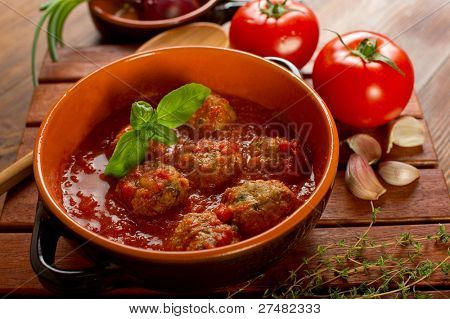 bowl with meatballs and tomato sauce