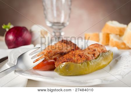 stuffer pepper on dish with fork
