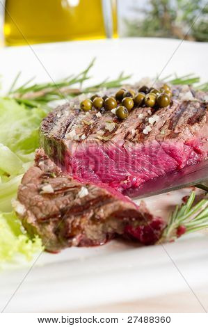 slice tenderloin with salad