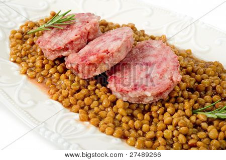 slice sausage with lentils on white