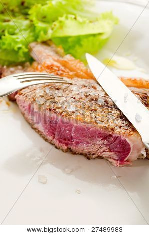 slice t-bone with salt