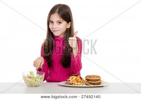 little girl with healthy and unhealthy food