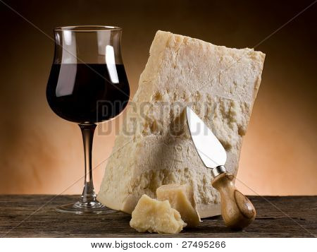 parmesan cheese and glass off red wine