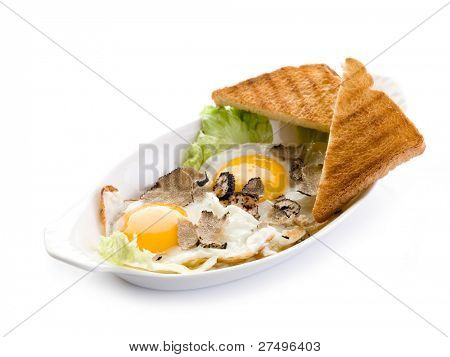 eggs with truffle and toasted bread