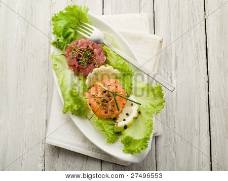 salmon and tuna tartar with green salad