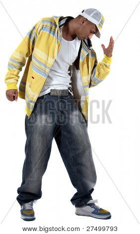 Dance-move Young man with clothes in hip-hop style showing a dance move over pure white background.