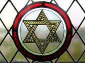 picture of stained glass  - A stained glass window in an old church.