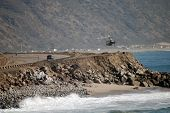 picture of pch  - Helicopter in pursuit filming simulatenously in Malibu California on Pacific Coast Highway in Los Angeles county on the Pacific Ocean - JPG