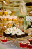 Table With Sweets Prepared For Party. Candy Bar. Delicious Sweet Buffet With Cupcakes. Wedding Candy poster