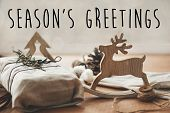 Seasons Greetings Text Sign On Stylish Christmas Rustic Gift Wrapped In Linen Fabric With Green Bra poster