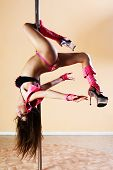 image of pole dance  - Sexy woman on the pole - JPG