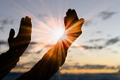 Silhouette Of Christian Man Hand Praying,spirituality And Religion,man Praying To God. Christianity  poster