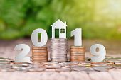 2019 New Year On Coins Stack For Saving Money And Financial Planning Concept, Saving To Buy A House poster