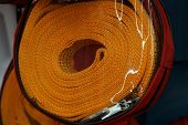 Orange Towing Cable In A Transparent Cellophane Package poster