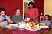 picture of biscuits gravy  - Family having thanksgiving dinner together in their home - JPG
