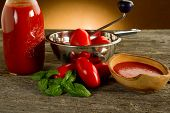 foto of household farm  - food mill with tomatoes and sauce - JPG