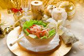 stock photo of christmas dinner  - shrimp cocktail on golden table - JPG