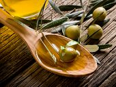 olive oil over wood spoon