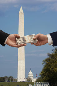 pic of lobbyist  - Hanshake in Washington DC with the Washington monument and capitol Hill in the background - JPG