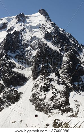 Aiguille du Midi cable car over snow mountain in Chamonix, France.