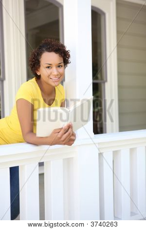 Pretty African Woman On Home Porch