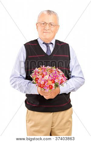 A mature gentleman holding bouquet of flowers isolated on white background