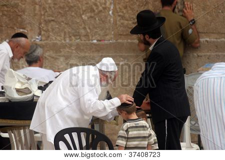 JERUSALEM - OCTOBER 03: Unidentified Jewish men pray at the western wall October 03, 2006 in Jerusalem, Israel. The wall is one of the holiest sites in Judaism attracting thousands of worshipers daily.