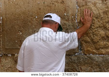 JERUSALEM - OCTOBER 03: Unidentified Jewish man prays at the western wall October 03, 2006 in Jerusalem, Israel. The wall is one of the holiest sites in Judaism attracting thousands of worshipers daily.