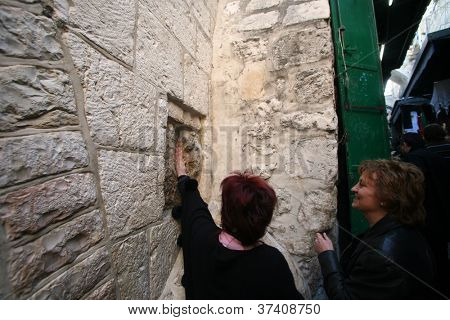 JERUSALEM - JANUARY 02: Via Dolorosa, 5th Stations of the Cross. The pilgrims who visit the Holy Land, pass the path that Jesus carried the cross to Calvary. Jerusalem, Israel on January 02, 2008.
