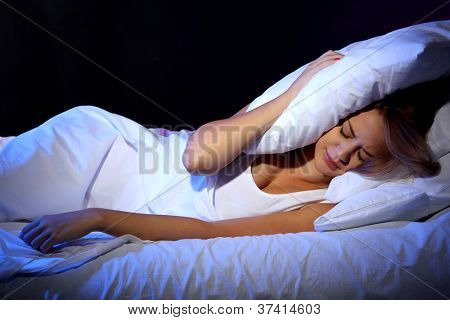 young beautiful woman lying on bed in bedroom
