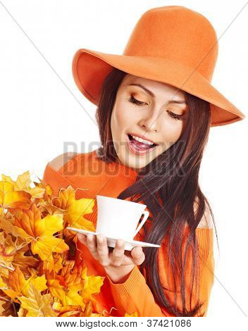 Woman holding  cup of coffee and orange leaves. Isolated.