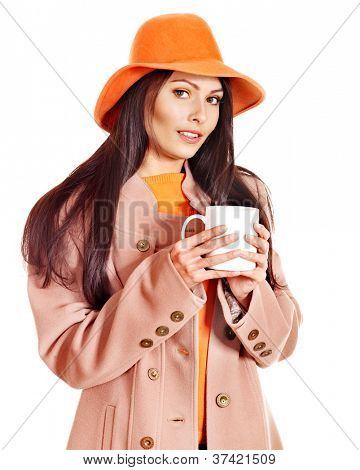Woman wearing autumn overcoat holding  cup of coffee.