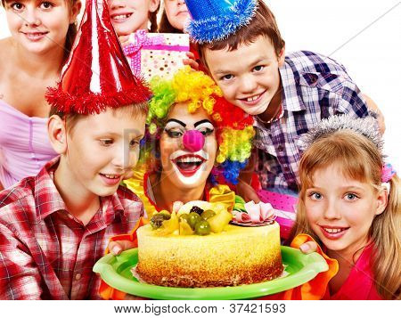 Birthday party of group teen with clown and cake. Isolated.