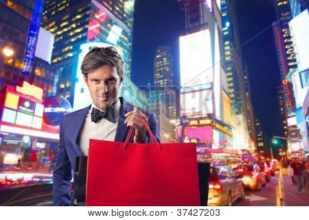 Fashionable holding a shopping bag in New York