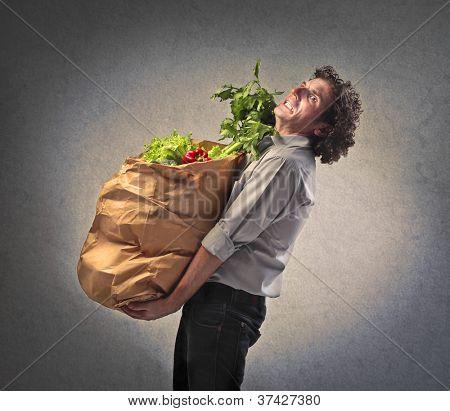 Man holding many vegetables