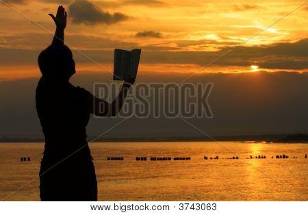 Female Praying With Bible