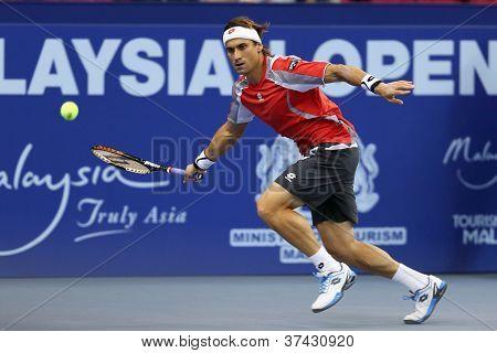 KUALA LUMPUR - SEP 28: David Ferrer (Spain) plays his quarter-final match at the ATP Tour Malaysian Open 2012 on September 28, 2012 at the Putra Stadium, Kuala Lumpur, Malaysia. He beat Igor Sijsling.