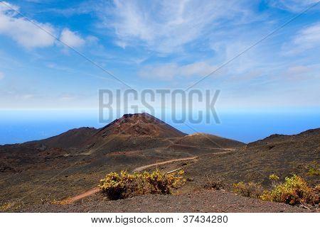 Teneguia volcano in La Palma Canary island with Atlantico ocean background