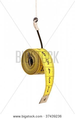 Fish hook with measure tape isolated on white background