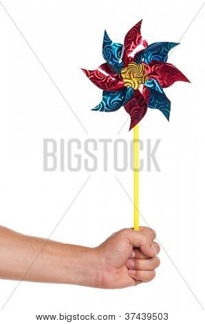 Man hand with colorful weathercock isolated on white background