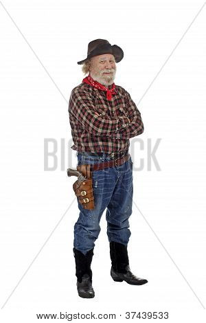 Smiling Old Cowboy Stands With Arms Crossed