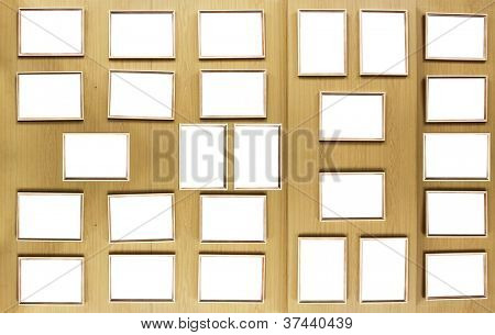 Set of vintage golden picture frames, isolated over wooden stand board