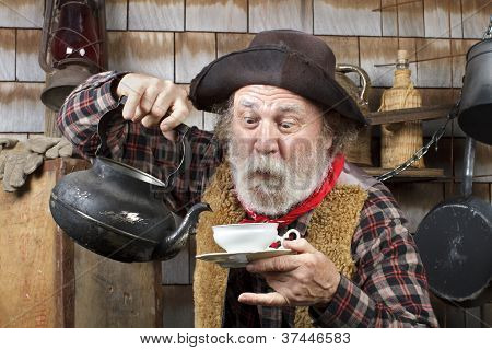 Old Cowboy With Kettle And China Tea Cup