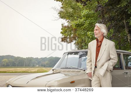 An image of a man in suit outdoor