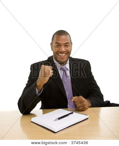 Man Sitting At Desk Closing Deal