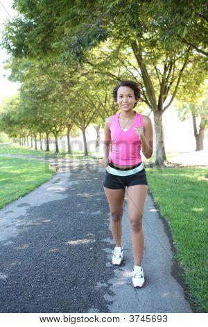 Pretty Woman Jogging In Park