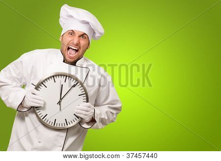 Chef Shouting And Holding A Clock On Green Background