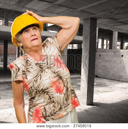 Senior Woman Wearing Hardhat On Site