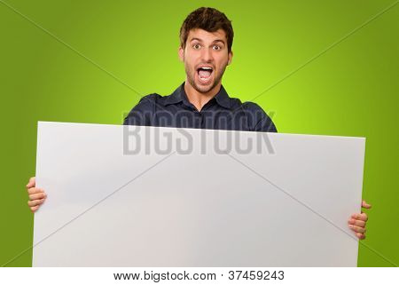 Surprised Man Holding Blank Placard On Green Background