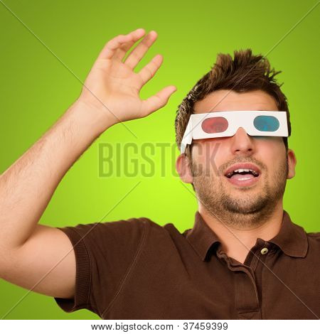 Portrait Of A Young Man Wearing 3d Glasses On A Green Background